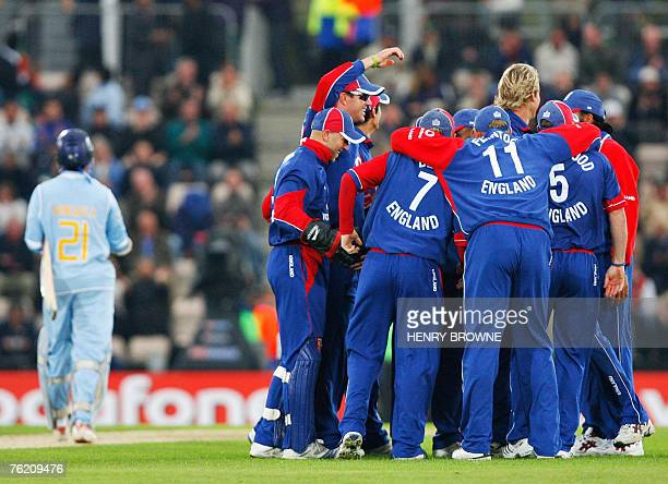 The England team celebrate as Indian Cricketer Sourav Ganguly walks back to the pavilion after being run out during the first NatWest One Day...