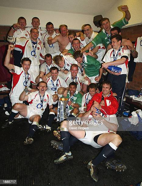 The England team celebrate in the dressing room after winning the Grand Slam after the RBS Rugby Union International match between Ireland and...