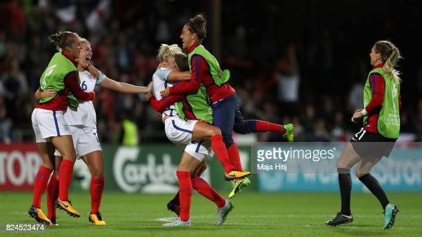 The England team celebrate victory after the UEFA Women's Euro 2017 Quarter Final match between France and England at Stadion De Adelaarshorst on...