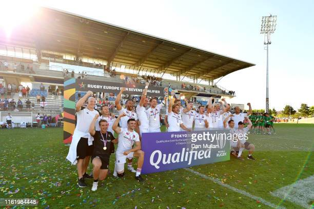 The England team celebrate victory and qualification for the Tokyo 2020 Olympic Games following the Cup Final match between France and England on day...