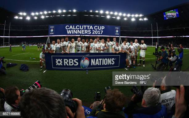 The England team celebrate with the Calcutta cup following their team's 6121 victory during the RBS Six Nations match between England and Scotland at...
