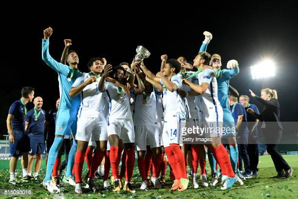 The England Team celebrate with the trophy after winning the UEFA European Under19 Championship Final between England and Portugal on July 15 2017 in...