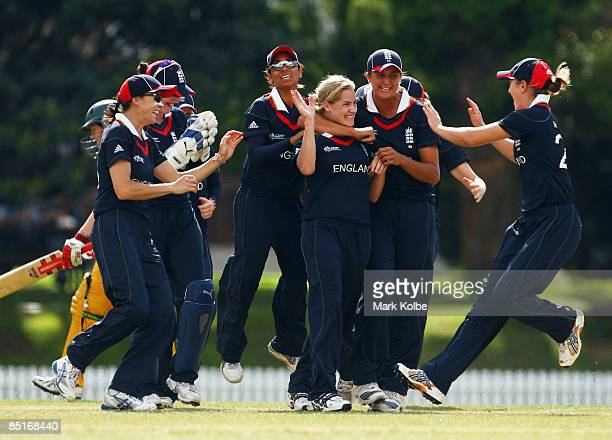 The England team congratulate Katherine Brunt after she took the wicket of Karen Rolton of Australia during the ICC Women's World Cup 2009 Warm Up...