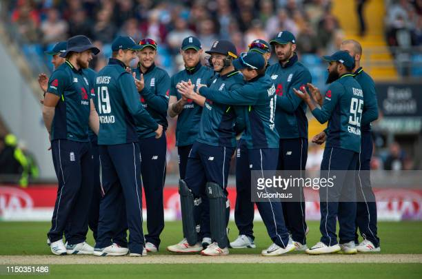 The England team congratulate wicket keeper Jos Buttler after he runs out Sarfaraz Ahmed of Pakistan during the fifth One Day International between...