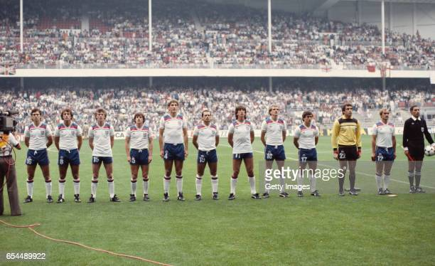 The England team kitted out in their splendid Admiral strips look on during the national anthems before their 1982 FIFA World Cup Second Round Group...