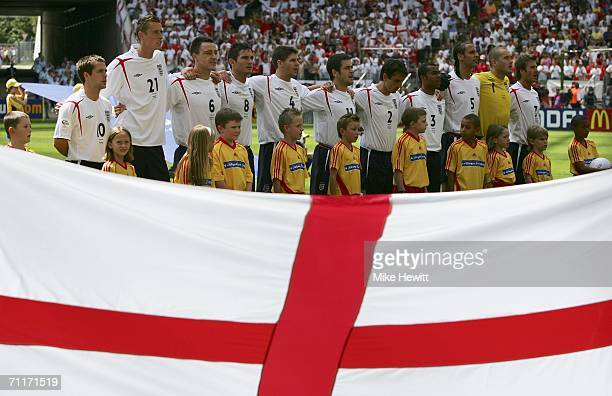 The England team line up for the national anthem during the FIFA World Cup Germany 2006 Group B match between England and Paraguay at the Stadium...