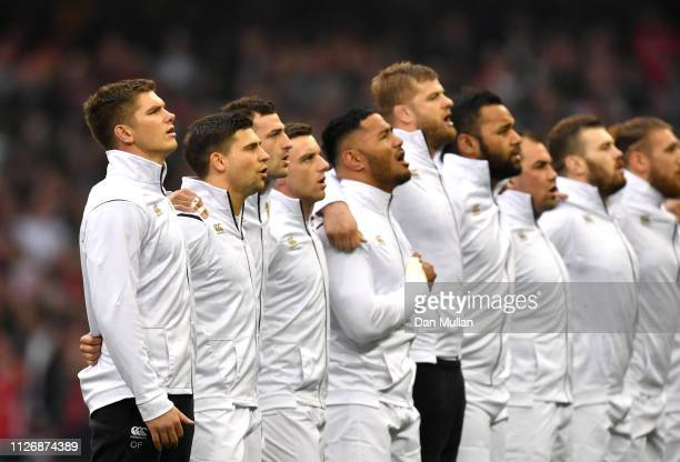 The England team line up for the national anthem prior to the Guinness Six Nations match between Wales and England at Principality Stadium on...