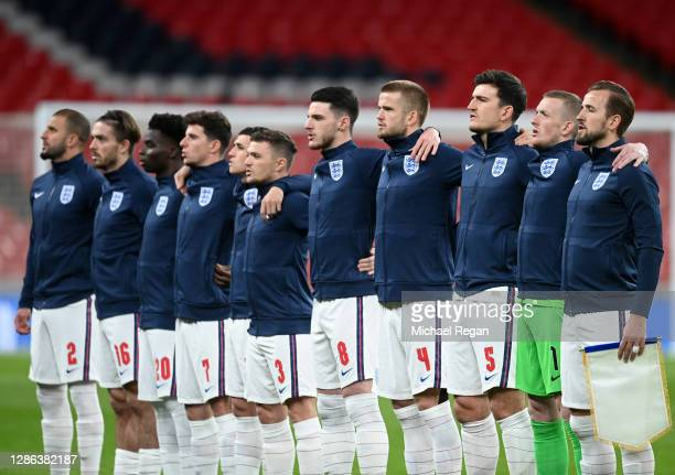 The England team line up for the national anthem prior to the UEFA Nations League group stage match between England and Iceland at Wembley Stadium on...