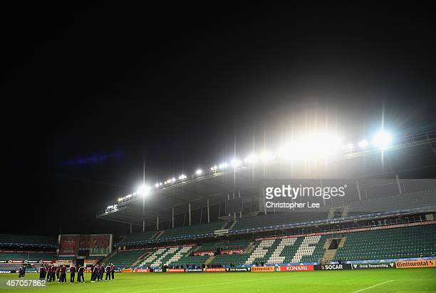 The England team look at the pitch and stadium during the England Training and Press Conference at A Le Coq Arena on October 11 2014 in Tallinn...