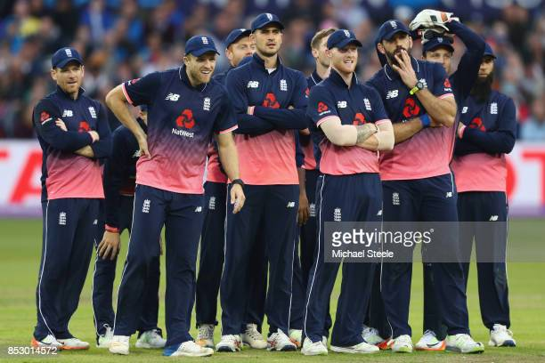 The England team look towards the tv screen as they await the run out decision on Chris Gayle's wicket during the third Royal London One Day...