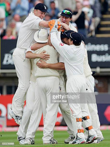 The England Team mob team mate Ashley Giles after he took the wicket of Ricky Ponting of Australia during day two of the Second npower Ashes Test...