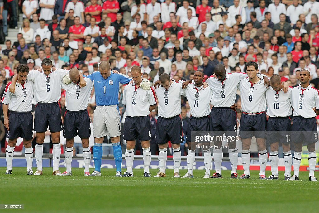 The England team observe a minute's silence for murdered hostage Ken Bigley ahead of the England v Wales World Cup qualifier at Old Trafford on 9 October 2004 in Manchester, England.