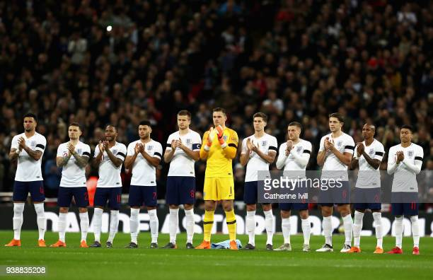 The England team observe a minutes silence in memory of Jimmy Armfield Cyrille Regis and Davide Astori prior to the International friendly between...