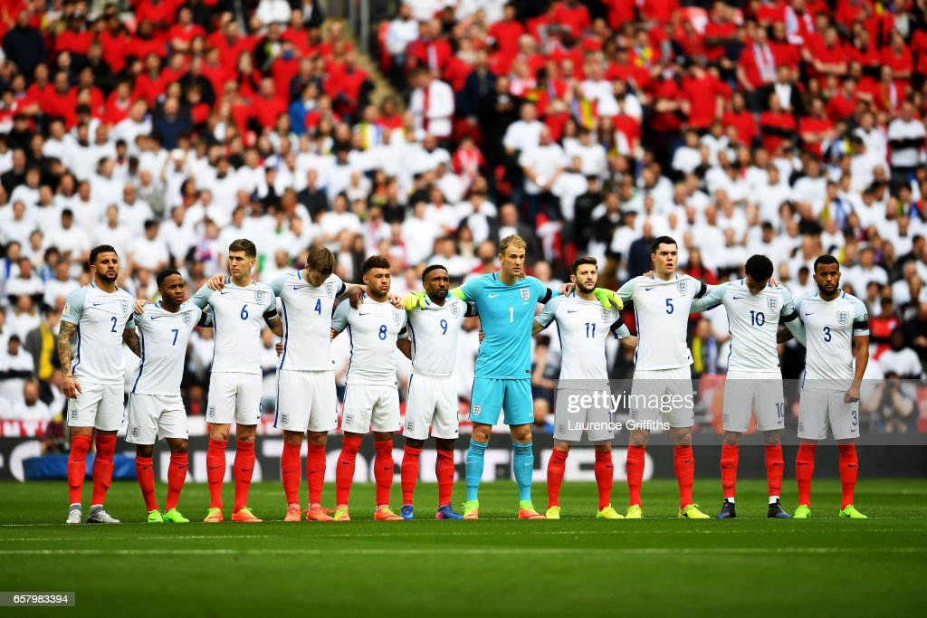 The England team observe a one minute silence to remember those who lost their lives in the recent Westminster terrorist attacks prior to the FIFA 2018 World Cup Qualifier between England and Lithuania at Wembley Stadium on March 26, 2017 in London, England.