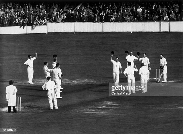 The England team pay tribute to Donald Bradman the Australian captain playing in his last Test Match at the Oval London Sir Donald Bradman was the...