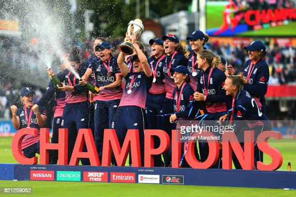 The England team pose for a photo after victory in the ICC Women's World Cup 2017 Final between England and India at Lord's Cricket Ground on July 23...