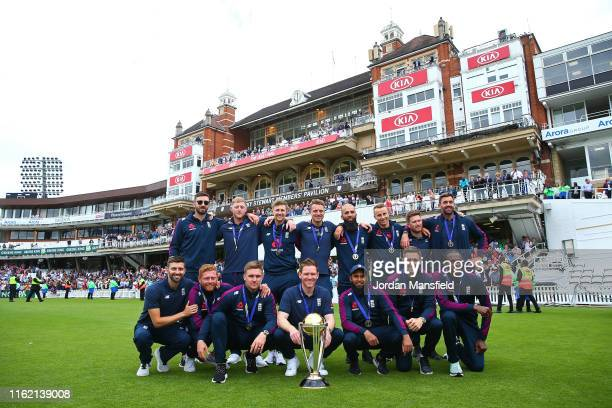 The England team pose for a photo with the World Cup during the England ICC World Cup Victory Celebration at The Kia Oval on July 15, 2019 in London,...