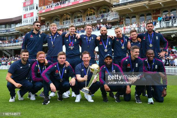 The England team pose for a photo with the World Cup Trophy during the England ICC World Cup Victory Celebration at The Kia Oval on July 15 2019 in...