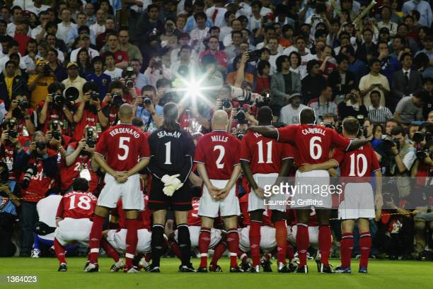 The England team pose for a team photo before the England v Argentina, Group F, World Cup Group Stage match played at the Sapporo Dome in Sapporo,...