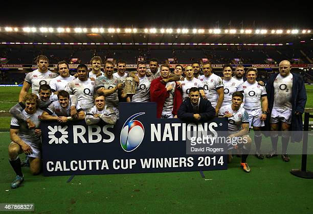 The England team pose with The Calcutta Cup after victory in the RBS Six Nations match between Scotland and England at Murrayfield Stadium on...