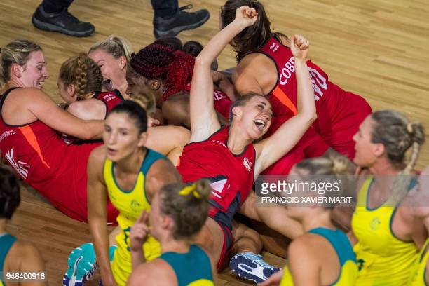 TOPSHOT The England team poses with their gold medals after beating Australia in the women's netball gold medal match during the 2018 Gold Coast...