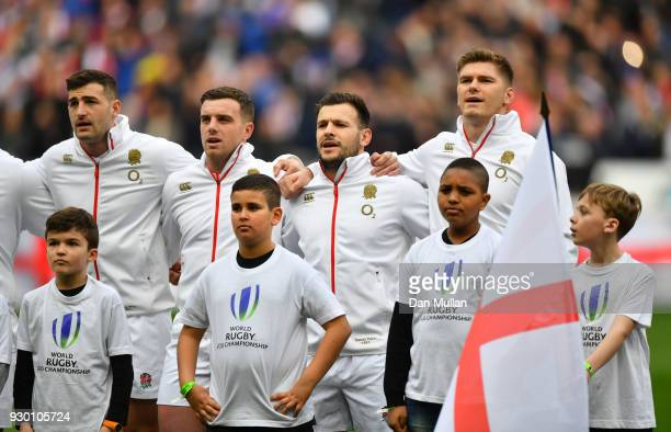 The England team sign the national anthem prior to the NatWest Six Nations match between France and England at Stade de France on March 10 2018 in...