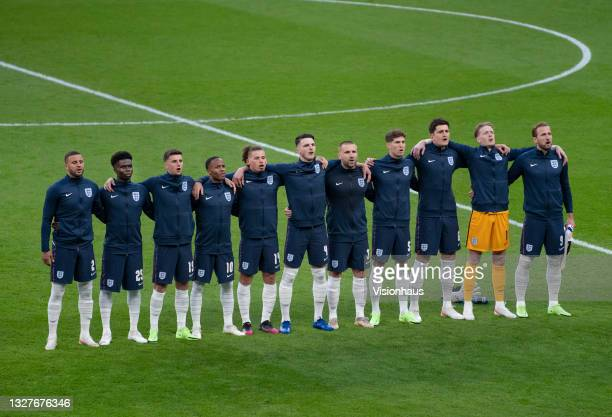 The England team sing the national anthem before the UEFA Euro 2020 Championship Semi-final match between England and Denmark at Wembley Stadium on...