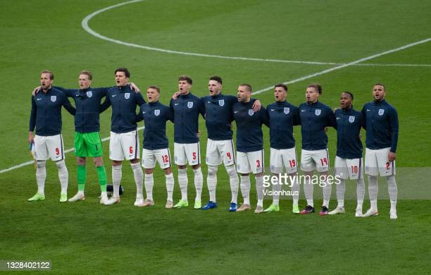 The England team sing the national anthem before the UEFA Euro 2020 Championship Final between Italy and England at Wembley Stadium on July 11, 2021...