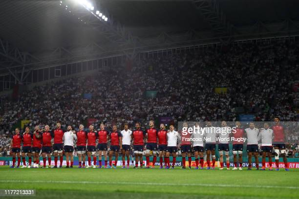 The England team sing the national anthem prior to the Rugby World Cup 2019 Group C game between England and USA at Kobe Misaki Stadium on September...