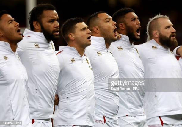 The England Team sing the National Anthem prior to the Under Armour Summer Series match between Wales and England at Principality Stadium on August...