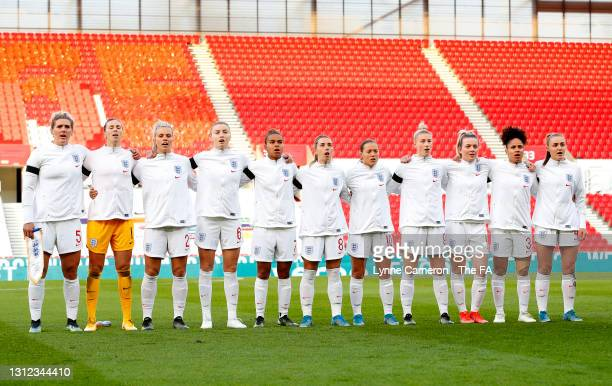 The England team take part in the national anthem prior to the International Friendly match between England and Canada at Bet365 Stadium on April 13,...