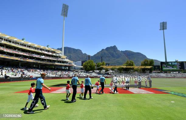 The England team take to the field prior to the First One Day International match between South Africa and England at Newlands on February 04, 2020...