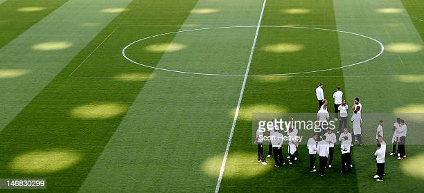 The England team walk around the pitch during an England training session at Olympic Stadium on June 23, 2012 in Kiev, Ukraine.