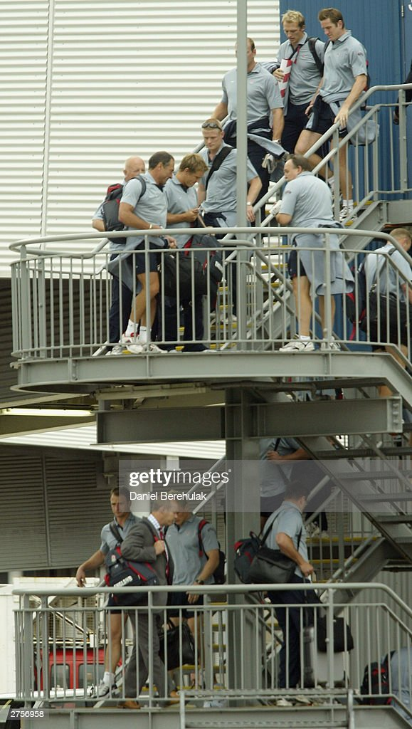 The England team walk down stairs towards their British Airways BA16 aircraft during the departure of the England Rugby team at Sydney International Airport November 24, 2003 in Sydney, Australia. (Photo by Daniel Berehulak/Getty Images) The England Rugby Team depart Sydney victorious after winning the Rugby World Cup defeating Australia 20:17 in the final.