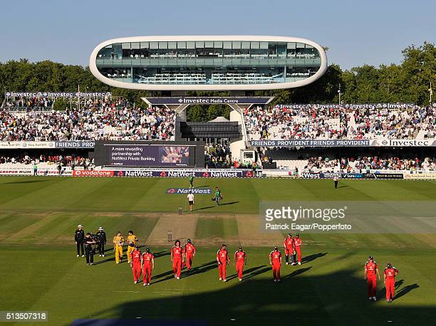 The England team walk off the pitch followed by the Australian batsmen and the umpires after Australia win the NatWest Series One Day International...