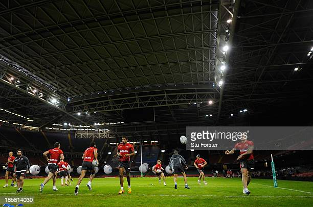 The England team warm up during the England captains run ahead of tomorrows opening match of the 2013 Rugby League World Cup against Australia at...