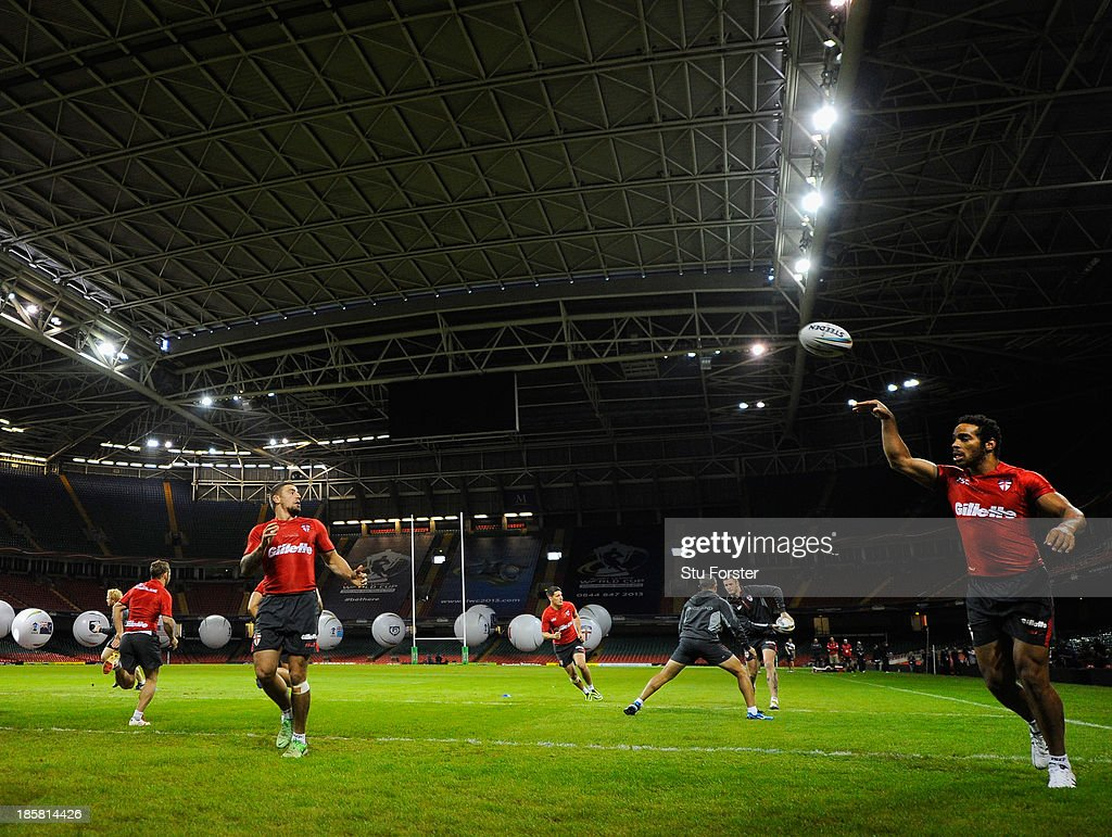 The England team warm up during the England captains run, ahead of tomorrows opening match of the 2013 Rugby League World Cup against Australia at Millennium Stadium on October 25, 2013 in Cardiff, Wales.