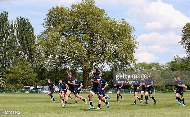 The England team warm up during the England training session held at the Lensbury Club on May 19 2014 in Teddington England