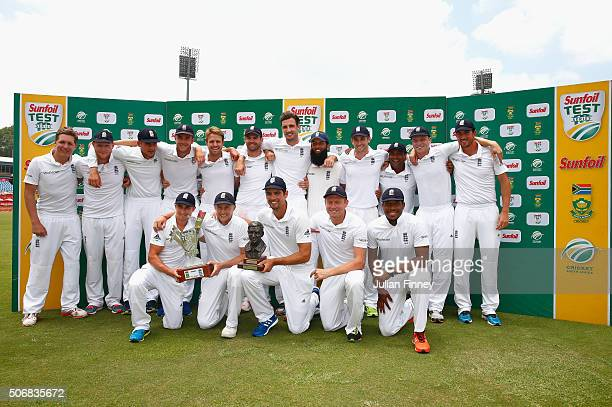 The England team with the Basil D'Oliveira trophy after winning the series during day five of the 4th Test at Supersport Park on January 26 2016 in...