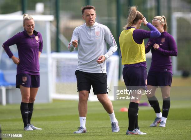 The England Women's Manager Phil Neville gives instructions during an England Women Training Session at the American Express Elite Football...