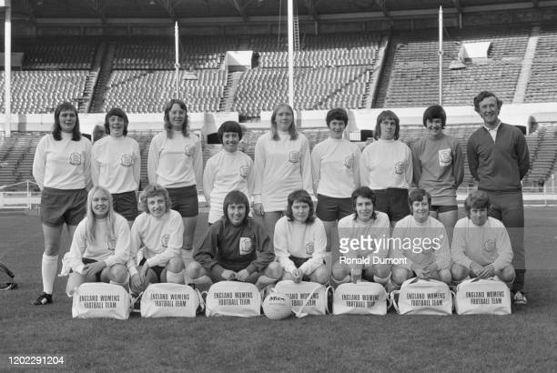 The England women's national football team and their manager, Eric Worthington, line-up for a team portrait at Wembley Stadium in London, England,...