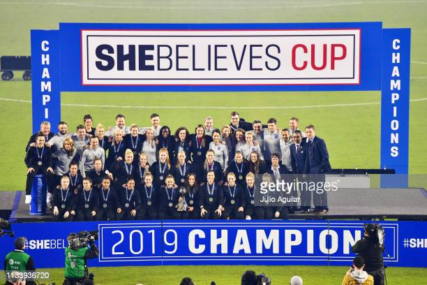 The England Women's National Team poses with the trophy after winning the She Believes Cup at Raymond James Stadium on March 05 2019 in Tampa Florida