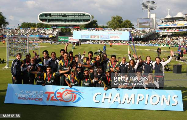 The England women's team joins the men's Pakistan's team in joint winners photo to celebrate their victory's during the Final of the ICC World...