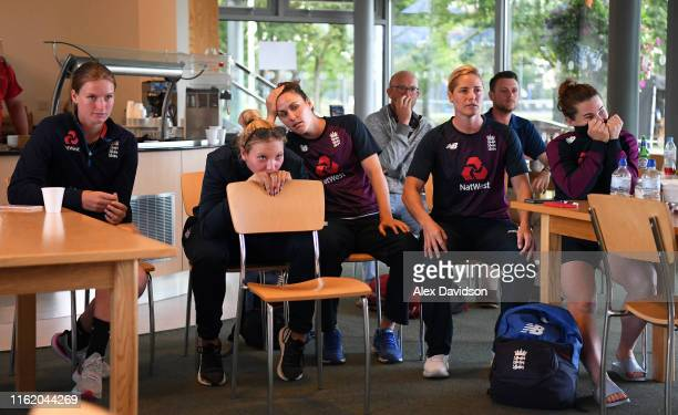The England Women's team reacts to England men going to a Super Over in the Final of the ICC Cricket World Cup against New Zealand during Day Three...