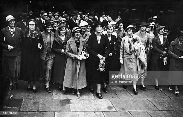 The England Women's Test Cricket team with a crowd of wellwishers at St Pancras station London before leaving to play in Australia 19th October 1934...