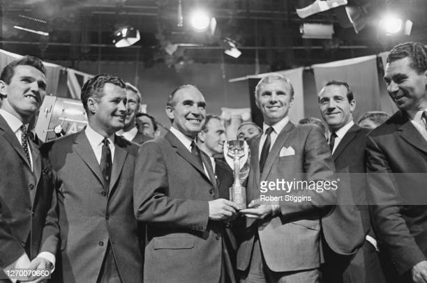 The England World Cup team holding the Jules Rimet trophy as they celebrate their win in the final, 31st July 1966. From left to right, Terry Paine,...