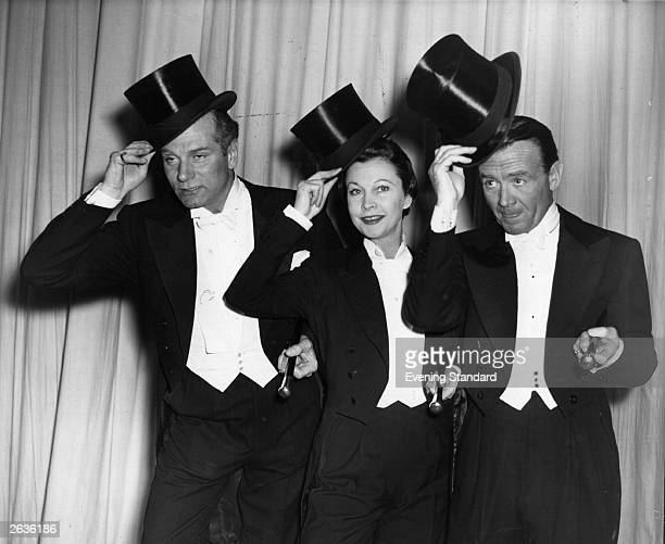 The English actor and director Sir Laurence Olivier his wife Lady Olivier and John Mills during a rehearsal for the Royal Variety Performance