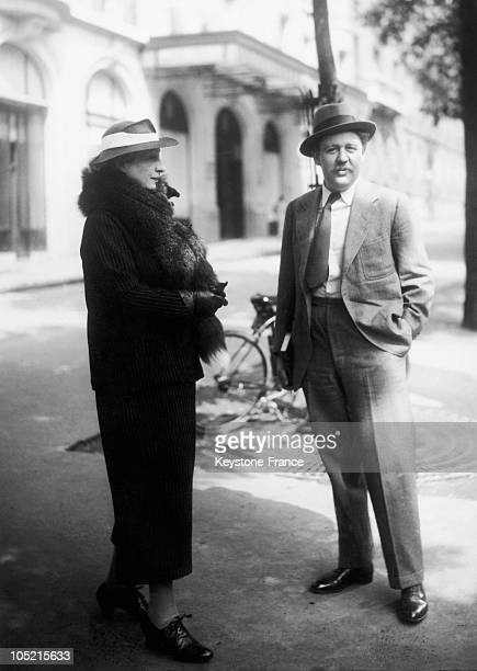 The English Actor Charles Laughton Talking With A Woman In A Street Of Paris On May 4 1936