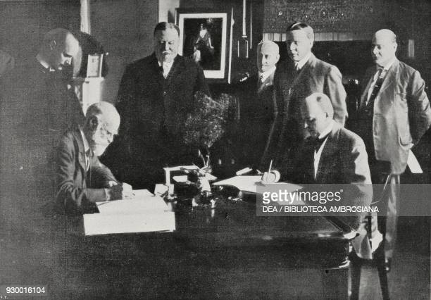 The English ambassador Bryce and Minister Knox signing the arbitration treaty between the United States of America England and France in the centre...