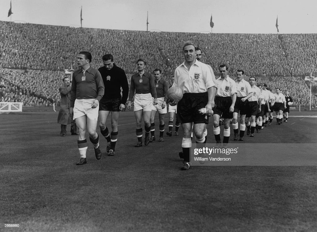 The English and Hungarian captains, Ferenc Puskas (left) and Billy Wright leading out their teams before a game at Wembley Stadium, London.